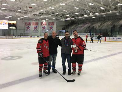 Joe Esposito (E-28), Joe Cammarata (E-157 retired), Rob Serra (RPF Board of Directors)  and Frank Heal (L-11 retired) show off the cup.