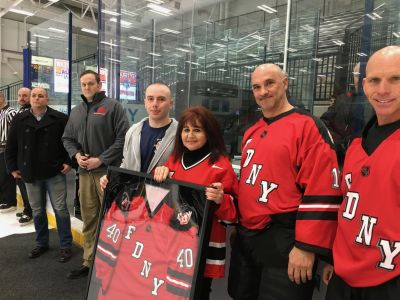 Ray's wife Caryn and son Terence were presented with a jersey in honor of Ray.