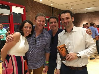 "Teresa & Andrew with Dan & Michael celebrating the release of the new book ""Finding John."""