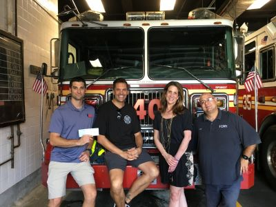 Craig, Lori and Joe of RPF received this small check for a huge donation from Chris and the NYC Stair Climb. Thanks to everyone around the globe for raising  $73,000 for The Ray Pfeifer Foundation!