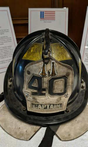 Retired Chief Jim Gormley donated his Captain's helmet worn during September 11 recovery work for our auction.