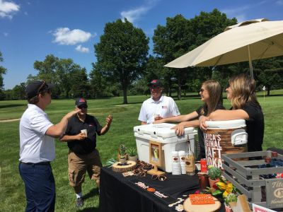"Tito's Handmade Vodka sponsored a ""Beverage Station"" on the course, plus our ""Cocktail Hour"" after golf."