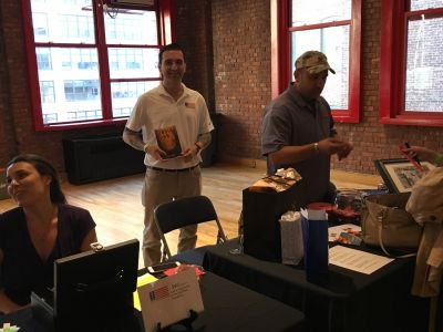 Rob helped sell books while Brian McGuire from RPF sold raffle tickets.