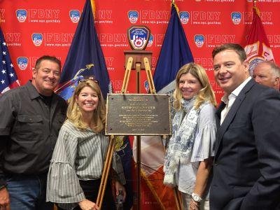 Joe, Kathleen, Maryellen and Dan Pfeifer honor their brother Ray at Engine 40/Ladder 35.